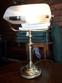 A brass effect reading light.