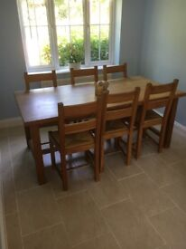 Solid oak six seater dining table and chairs