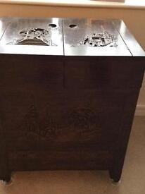Carved oriental dark wood storage/sewing cabinet