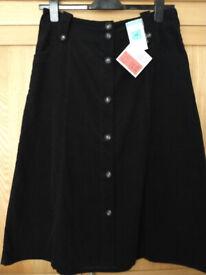Ladies skirt. Size 14. M & S. Black. Thin, cotton corduruoy. Waist 34inches.
