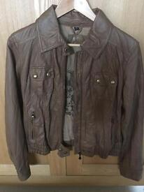 Guess ladies leather look jacket. Only worn a few times. Size small
