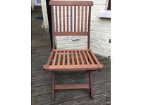 Four wooden patio garden chairs which fold away for handy storage in good condition