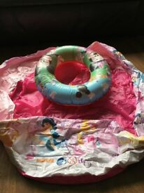 Disney princess puddling pool and Disney swimming ring