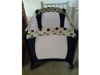 Travel cot with mattresses