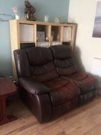 2 seater one side reclines. It's the other half of a 4 seater sofa. Good condition