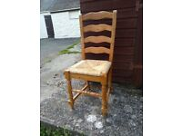 4x matching antique pine and wicker dining chairs.