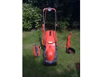 FLYMO ROLLERMO LAWNMOWER TOGETHER WITH STRIMMER AND LARGE B&D EXTENSION LEAD FOR SALE. COULD DELIVER