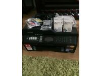 Brother printer and copier with extra print cartridges. Brand new. Can print photos too