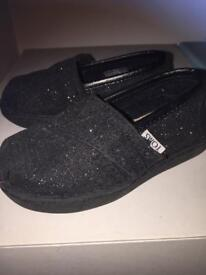 Black glitter TOMS infant shoes (size 4INT)