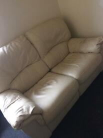 2 cream leather reclining couches