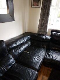 Soft black leather corner sofa
