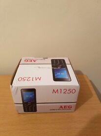 NEW GENUINE AEG M1250 2.4-INCH UK SIM-FREE MOBILE PHONE WITH BLUETOOTH