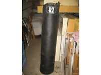 Punch bag with metal wall bracket