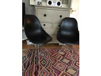 2 eames style chairs