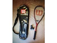 Wilson squash racquet with case and three balls.