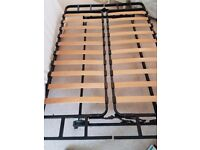 Ikea futon/sofa bed. Metal and wood frame with removable cream cushion.