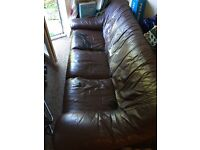 Free 3 seater Brown leather sofa. Few rips
