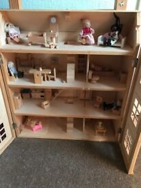 Dolls house solid wooden good condition