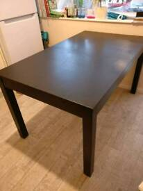 Table for 4 extendable to 8 people