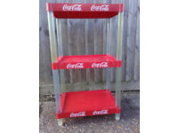 Red/clear 3-tier plastic shelving unit (coca cola logo)