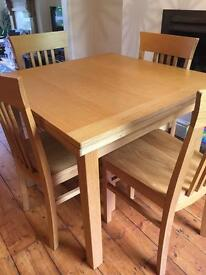 John Lewis extendable solid oak table and chairs