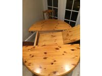 Extended Wooden Dining table and 4 chairs