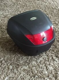Motorcycle storage box - great condition as hardly used comes with fittings