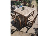 Teak table and 4 chairs.