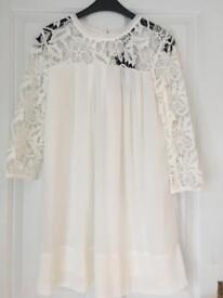 White dress with lace sleeves