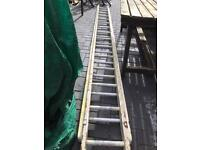 Double extension 24 1/2 ft wooden ladder with steel rungs