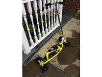 Yellow Fuzion 4 wheeled scooter