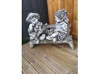 Garden ornament girl/boy and bench
