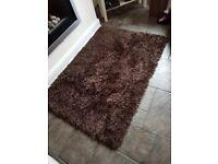 Brown shaggy rug.