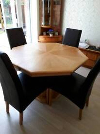 Oak extending dining table and 6 leather chairs