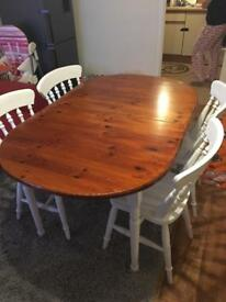 Farmhouse extended dining room table with four chairs