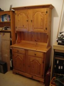 Pine dresser, beautifully carved with ornate brass hinges and round brass handles