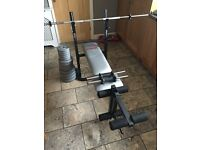 York b500 folding weight bench with bar and weights