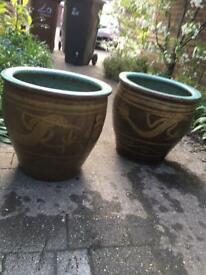 2 near- matching tall Planters
