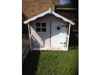 Childrens wooden wendy house for the garden.