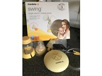 Medela swing single electric breast pump. Barely used! Also comes with Calma bottle never used.
