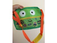 Children's green bag with a monster picture