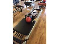 8 Reformer Pilates Beds!