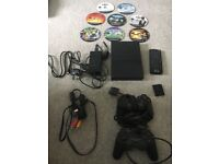 Sony PlayStation 2 with 8 games