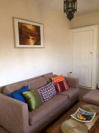 3 seater beige sofa with footstool