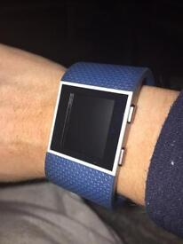 Blue Fitbit surge watch
