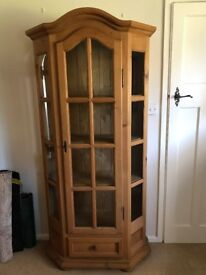 lockable glass cabinet and drawer at bottom. Solid wood. .