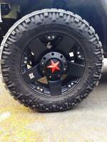 (4) 285/65r18 nitto trail grapplers rockstar rims