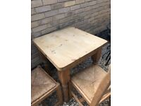 Solid timber pine dining table and two chairs