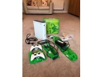 Xbox 360 console with hard drive, two controllers, 9 games (2 brand new) & wireless adaptor