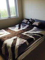 Queen size bed with IKEA side lamp
